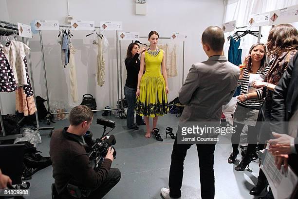 Fashion designer Jason Wu prepares a model backstage prior to the Jason Wu Fall 2009 Runway show during Mercedes-Benz Fashion Week at Exit Art, 475...