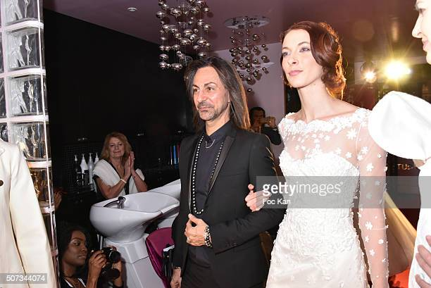 Fashion designer Jean Doucet and a 'Bride' walk the Runway during the Jean Doucet 'Bonheur Pour Tous' Gay and Lesbian Wedding dresses show as part of...