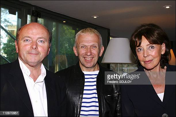 Fashion designer Jean Paul Gaultier and former minister Jacques Toubon and wife Lise in Paris France on July 06 2004