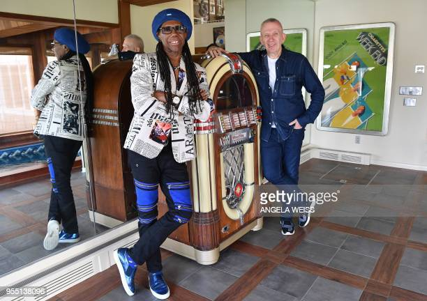 Fashion Designer Jean Paul Gaultier and Record Producer Nile Rodgers pose for a picture on May 3 2018 in Westport Connecticut Deciding how to tell...
