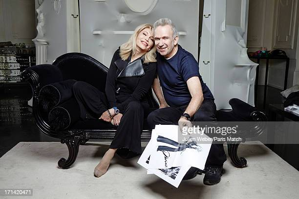 Fashion designer Jean Paul Gaultier and singer Amanda Lear are photographed for Paris Match on June 11 2013 in Paris France