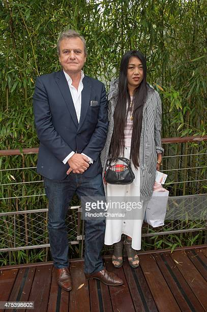 Fashion Designer JeanCharles de Castelbajac and his companion Jewelry Designer Ai Canno attend the French open at Roland Garros on May 31 2015 in...