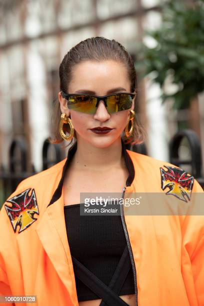 Fashion Designer Jeanne Touzet wears an Asger Juel Larsen jacket and Chanel earrings during London Fashion Week September 2018 on September 16 2018...