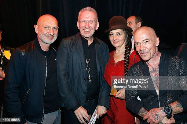 Fashion Designer JeanPaul Gaultier and Singer catherine Ringer standing between Artists 'Pierre et Gilles' pose Backstage after the Jean Paul...