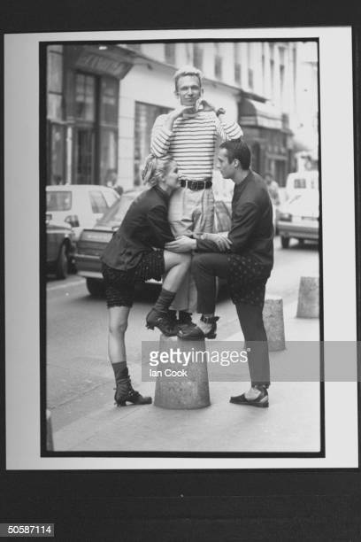 Fashion designer JeanPaul Gaultier w models showing off his designs incl male in doublebreasted suit w long polka dot shorts worn over the pants a...