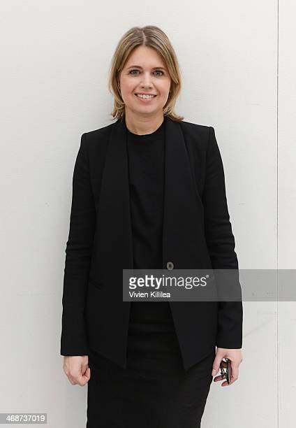 Fashion designer Jenny Packham poses backstage at Jenny Packham - Mercedes-Benz Fashion Week Fall 2014 at Industria Studios on February 11, 2014 in...