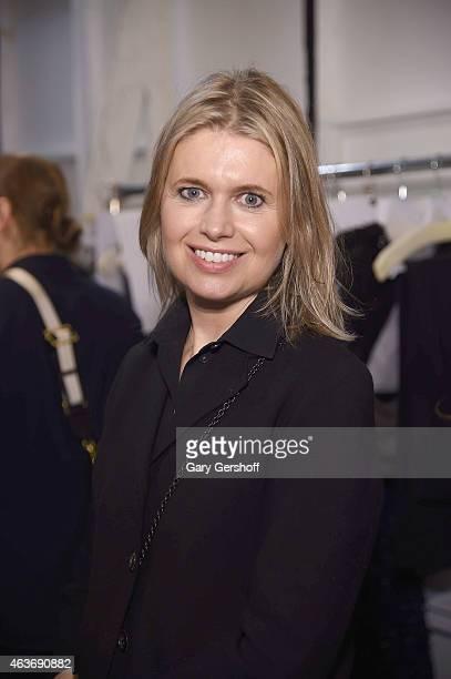 Fashion designer Jenny Packham poses backstage at the Jenny Packham fashion show during MercedesBenz Fashion Week Fall 2015 at Industria Studios on...