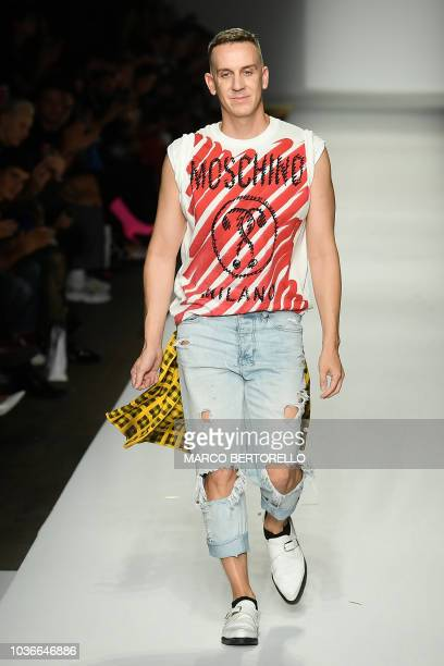 US fashion designer Jeremy Scott acknowledges applause following the presentation of the Moschino fashion collection during the Women's Spring/Summer...
