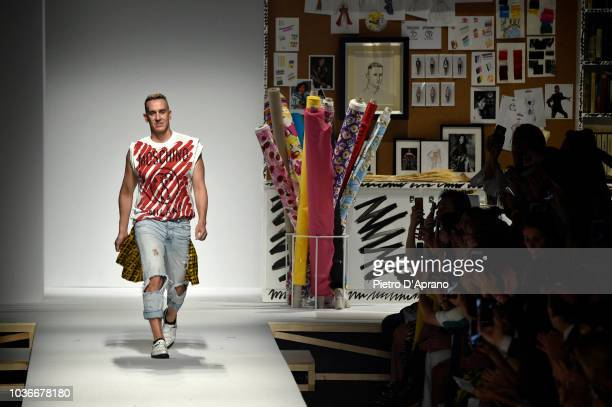 US fashion designer Jeremy Scott acknowledges the applause of the audience at the Moschino show during Milan Fashion Week Spring/Summer 2019 on...