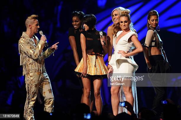 Fashion designer Jeremy Scott and Daisy Evans Ashley Shaw Chelsey Reynolds Monique Roberts Seyi Odedere of girl group From Above onstage during the...