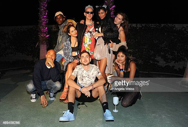 Fashion designer Jeremy Scott and friends enjoying Moet Ice Imperial at Moschino's Late Night hosted by Jeremy Scott at Coachella 2015 on April 11...