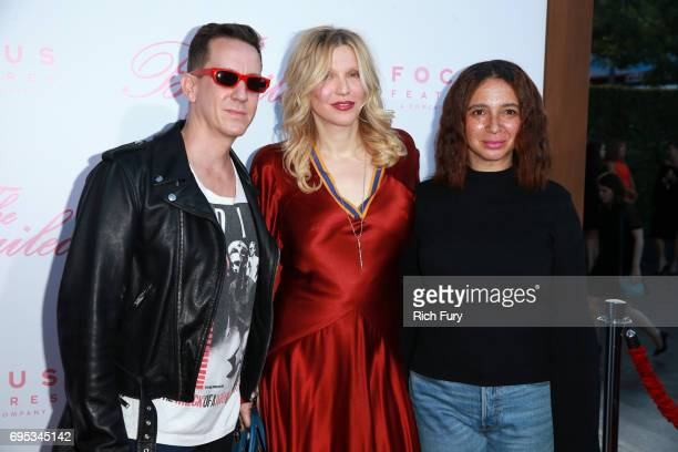 Fashion designer Jeremy Scott Courtney Love and actor Maya Rudolph attend the premiere of Focus Features' The Beguiled at the Directors Guild of...