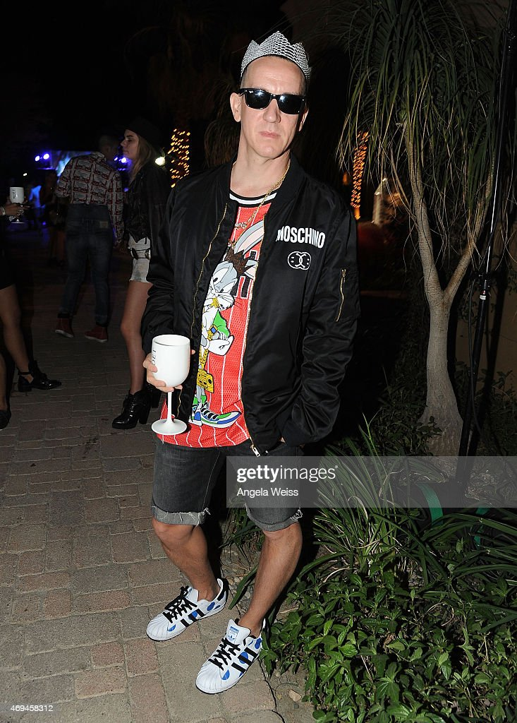 Fashion designer Jeremy Scott enjoying Moet Ice Imperial at Moschino's Late Night hosted by Jeremy Scott at Coachella 2015 on April 11, 2015 in Bermuda Dunes, California.