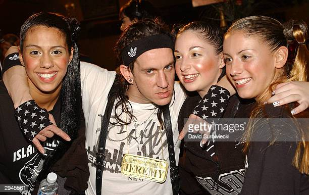 Fashion designer Jeremy Scott poses with models from the Island All Stars cheerleading team after his Jeremy Scott Fall/Winter 2004 fashion show at...