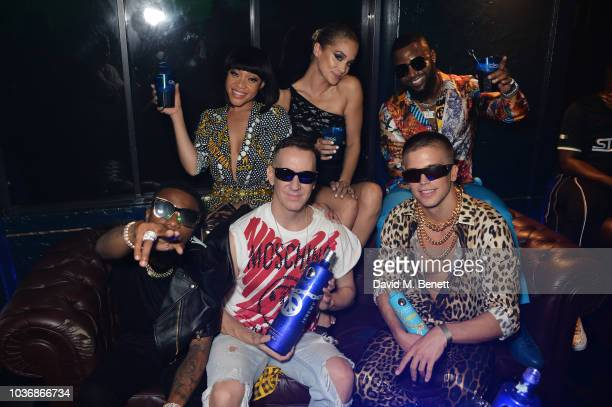 Fashion designer Jeremy Scott poses with WizKid Thando Thabethe Jasmine Saunders aka Golden Barbie Cassper Nyovest and River Viiperi of the CIROC X...