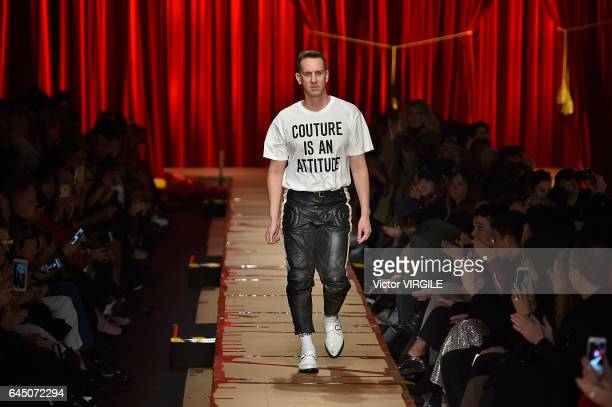 Fashion designer Jeremy Scott walks the runway at the Moschino Ready to Wear fashion show during Milan Fashion Week Fall/Winter 2017/18 on February...