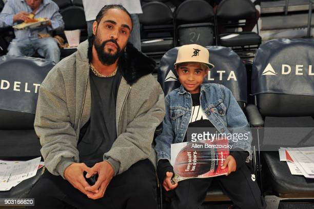 Fashion designer Jerry Lorenzo and his son attend a basketball game between the Los Angeles Lakers and the Sacramento Kings at Staples Center on...