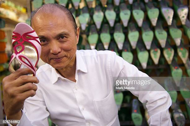 Fashion designer Jimmy Choo in his studio on Cannaught Street with a pair of bespoke shoes.