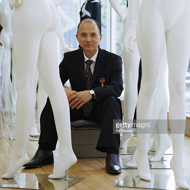 Fashion designer Jimmy Choo poses for a portrait shoot for the Sunday Telegraph in London on June 12, 2003.