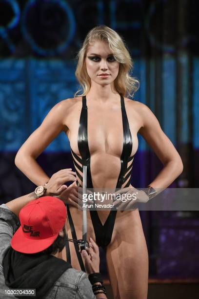 PROJECT fashion designer Joel Alvarez doing live fashion on the runway with a model during the BLACK TAPE PROJECT show at New York Fashion Week...