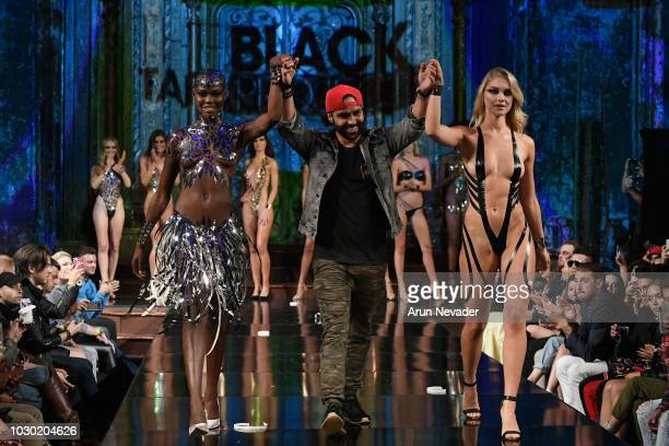 PROJECT fashion designer Joel Alvarez walks the runway with a model during the BLACK TAPE PROJECT show at New York Fashion Week Powered By Art Hearts...