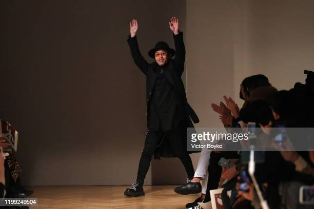 Fashion designer Jonny Fu acknowledges the applause of the audience at the Reshake fashion show on January 13 2020 in Milan Italy