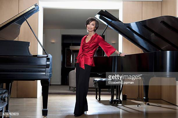 Fashion designer Josie Natori is photographed in her music room for New York Post on December 2, 2009 in New York City. PUBLISHED IMAGE.