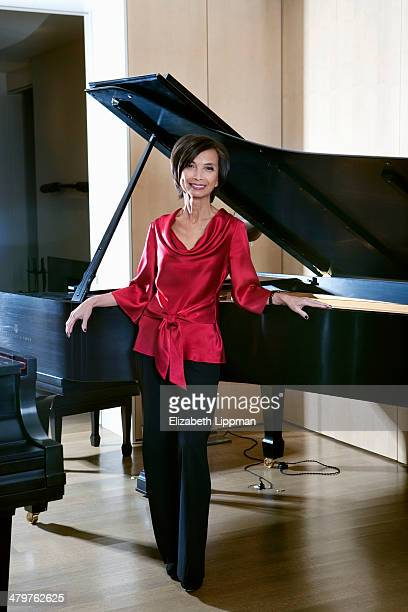 Fashion designer Josie Natori is photographed in her music room for New York Post on December 2, 2009 in New York City.