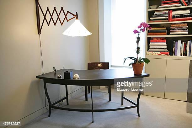 Fashion designer Josie Natori's home is photographed for New York Post on December 2, 2009 in New York City. A Calvin Tsao-designed bronze desk.