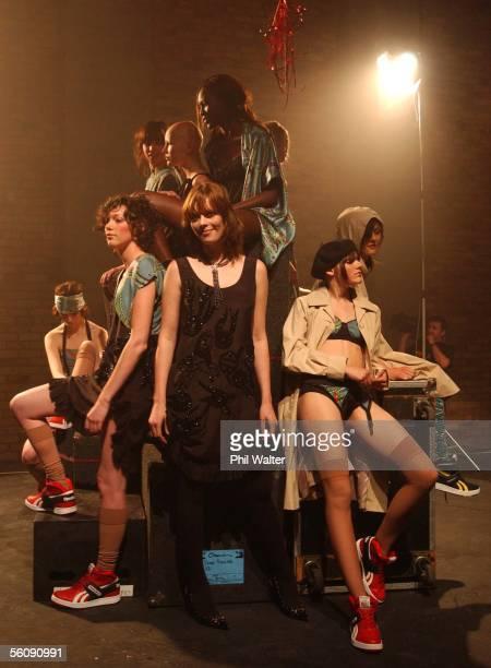 Fashion designer Karen Walker poses with her models on a rotating stage inside the York Street recording studios in Parnell during the final day of...