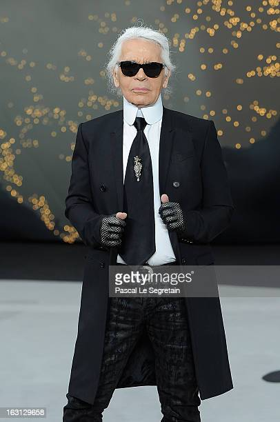 Fashion designer Karl Lagerfeld acknowledges applause following Chanel Fall/Winter 2013 ReadytoWear show as part of Paris Fashion Week at Grand...