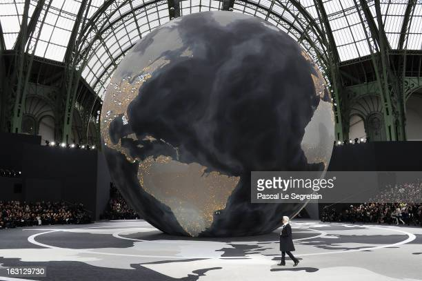 Fashion designer Karl Lagerfeld acknowledges applause following Chanel Fall/Winter 2013 Ready-to-Wear show as part of Paris Fashion Week at Grand...