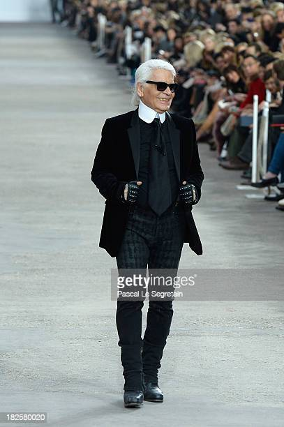 Fashion designer Karl Lagerfeld acknowledges applause following the Chanel show as part of the Paris Fashion Week Womenswear Spring/Summer 2014 at...