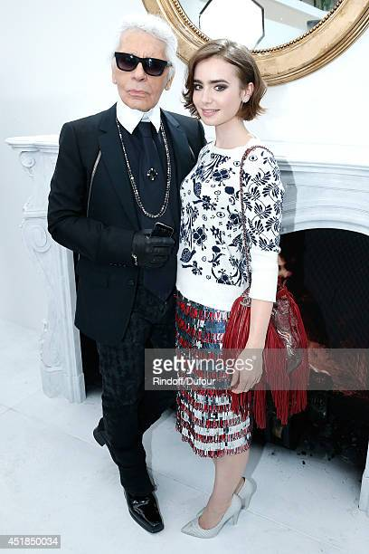Fashion designer Karl Lagerfeld and Actress Lily Collins pose backstage after the Chanel show as part of Paris Fashion Week Haute Couture Fall/Winter...