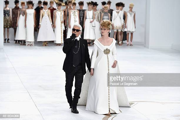 Fashion designer Karl Lagerfeld and Ashleigh Good aknowledge the applause of the audience after the Chanel show as part of Paris Fashion Week Haute...
