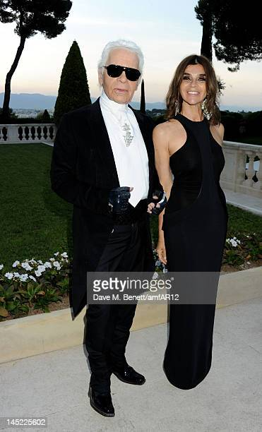 Fashion designer Karl Lagerfeld and Editor in Chief of CR FashionBook Carine Roitfeld attend the 2012 amfAR's Cinema Against AIDS during the 65th...