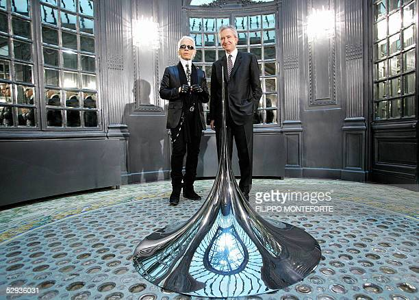 Fashion designer Karl Lagerfeld and French luxury goods group LVMH Moet Hennessy Louis Vuitton chief executive Bernard Arnault pose inside the new...