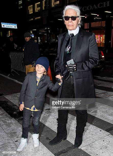 Fashion designer Karl Lagerfeld and his godson Hudson Kroenig are seen arriving to Fendi New York Flagship Boutique Inauguration Party during...