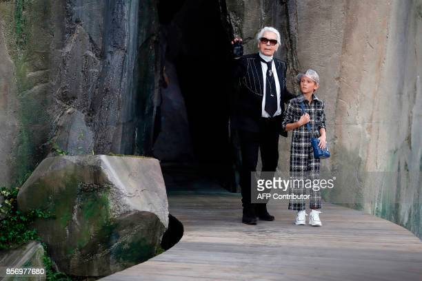 Fashion designer Karl Lagerfeld and his godson Hudson Kroenig acknowledge the audience at the end of Chanel women's 2018 Spring/Summer readytowear...