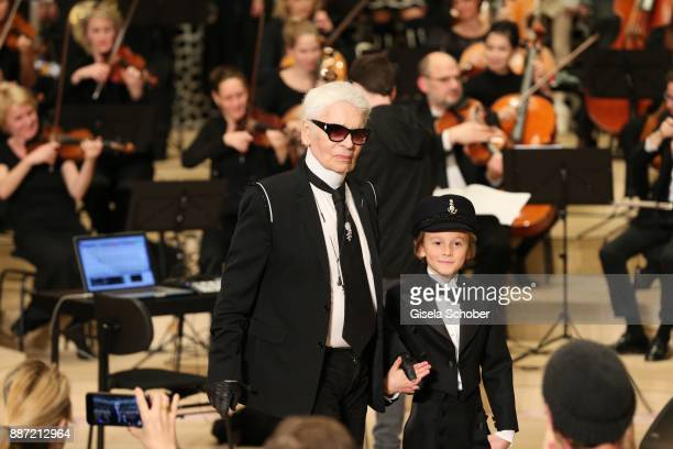 Fashion designer Karl Lagerfeld and Hudson Kroenig during the Chanel Trombinoscope collection Metiers d'Art 2017/18 show at Elbphilharmonie on...