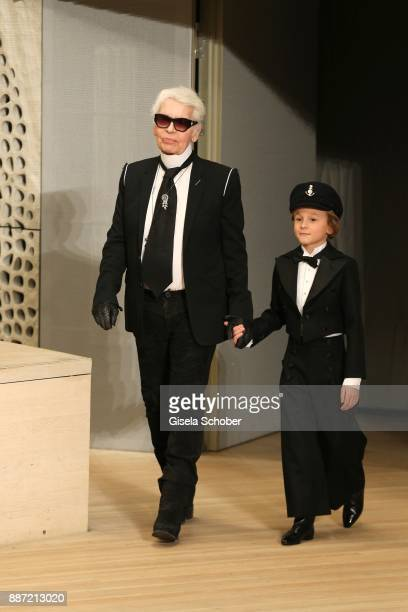 Fashion designer Karl Lagerfeld and Hudson Kroenig during the Chanel 'Trombinoscope' collection Metiers d'Art 2017/18 show at Elbphilharmonie on...