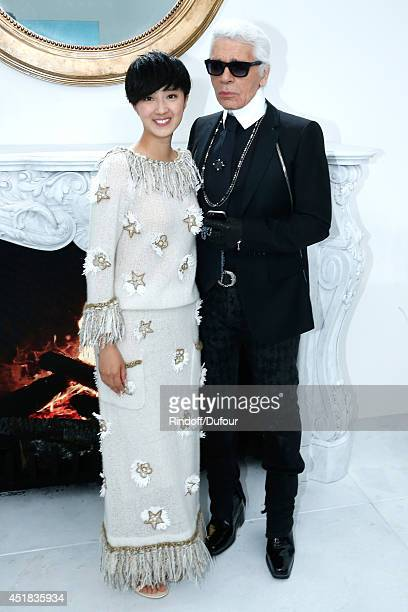 Fashion designer Karl Lagerfeld and Kwai LunMei pose backstage after the Chanel show as part of Paris Fashion Week Haute Couture Fall/Winter 20142015...