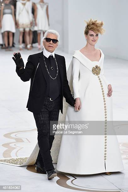 Fashion designer Karl Lagerfeld and model Ashleigh Good aknowledge the applause of the audience after the Chanel show as part of Paris Fashion Week -...