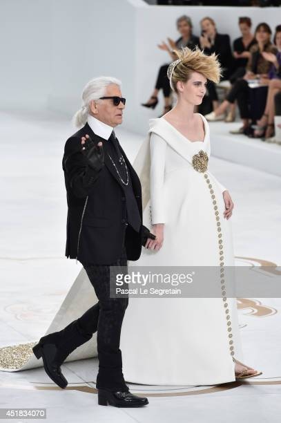 Fashion designer Karl Lagerfeld and model Ashleigh Good aknowledge the applause of the audience after the Chanel show as part of Paris Fashion Week...