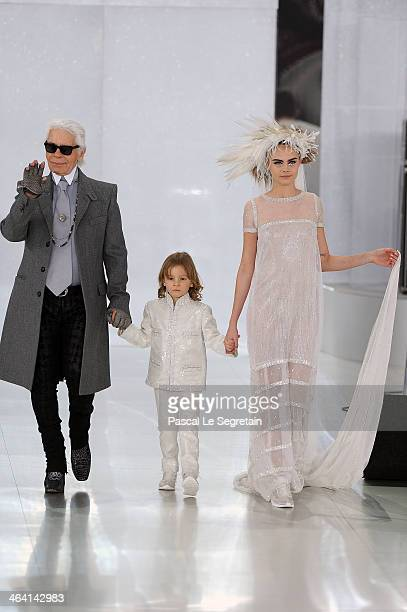 Fashion designer Karl Lagerfeld and model Cara Delevingne walk the runway during the Chanel show as part of Paris Fashion Week HauteCouture...
