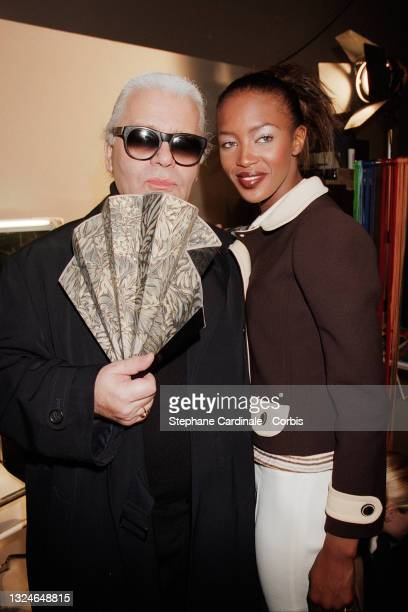 Fashion designer Karl Lagerfeld and model Naomi Campbell pose after the Lagerfeld Ready to Wear Fall/Winter 1996/97 show as part of Paris Fashion...