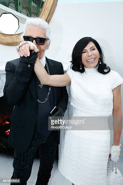 Fashion designer Karl Lagerfeld and Mouna Ayoub pose backstage after the Chanel show as part of Paris Fashion Week Haute Couture Fall/Winter 20142015...