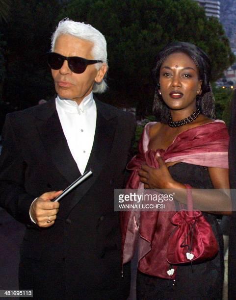 Fashion designer Karl Lagerfeld and singer Khadja Nin arrive 03 August 2001 at the Red Cross Ball in Monaco le styliste Karl Lagerfeld et la...