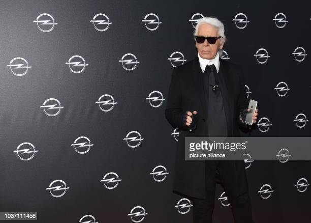 Fashion designer Karl Lagerfeld arrives at the vernissage for his photo calender 'Corsa Karl and Choupette' at the Palazzo Italia in Berlin Germany...