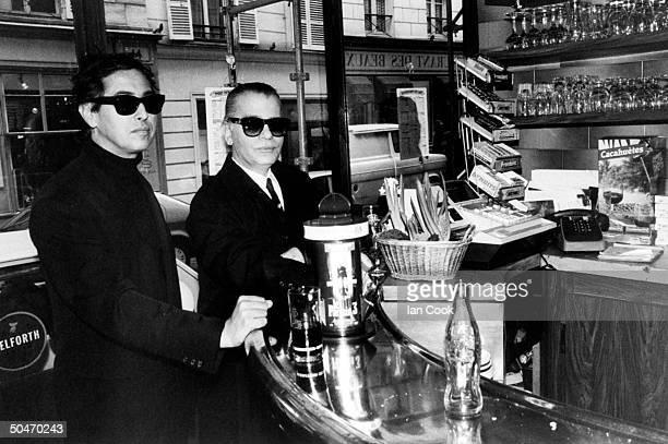 Fashion designer Karl Lagerfeld assist Gilles Du Four drinking coke at bar